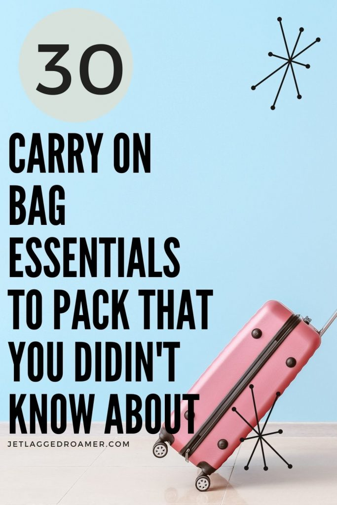 Picture of a pink suitcase and tax that reads 30 carry-on bag essentials to pack that you didn't know about.