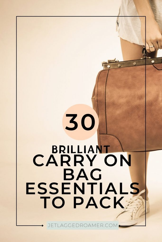 Woman holding a leather carry on bag words on image safe 30 brilliant carry on bag essentials to pack.