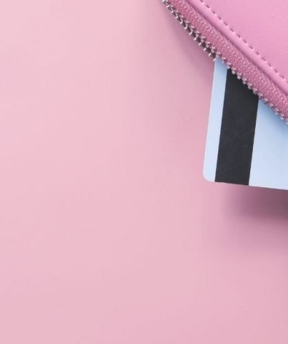 credit card in a pink wallet