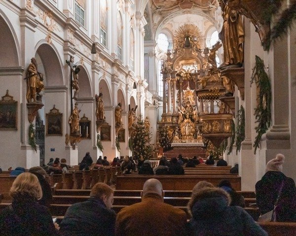 Inside St. Peter's Church with a family sitting on a pew