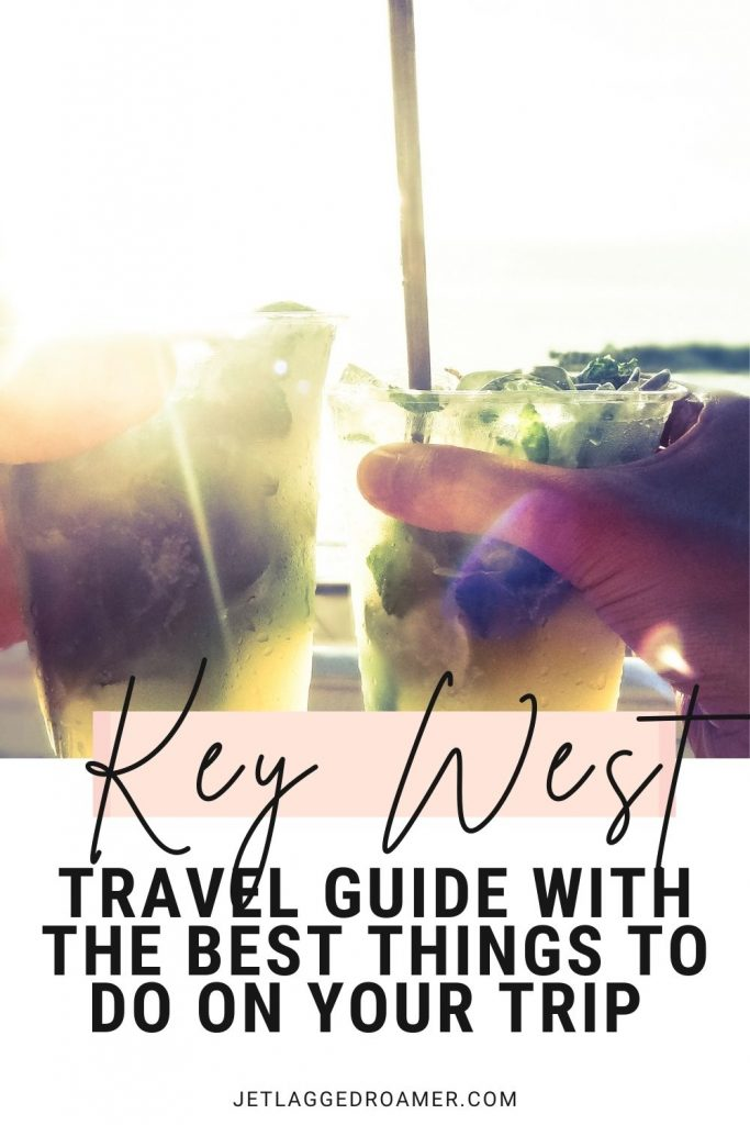 Two people doing a cheers with tropical drinks. Text reads Key West travel guide with the best things to do on your trip.