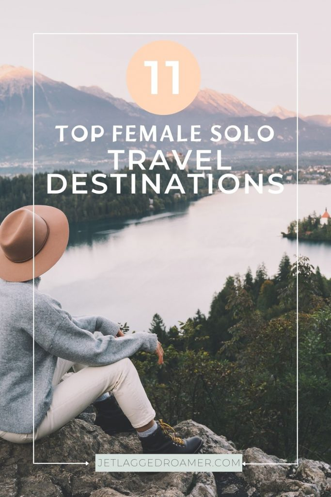 Woman sitting on a mountain overlooking a river. Text says 11 top female solo travel destinations.