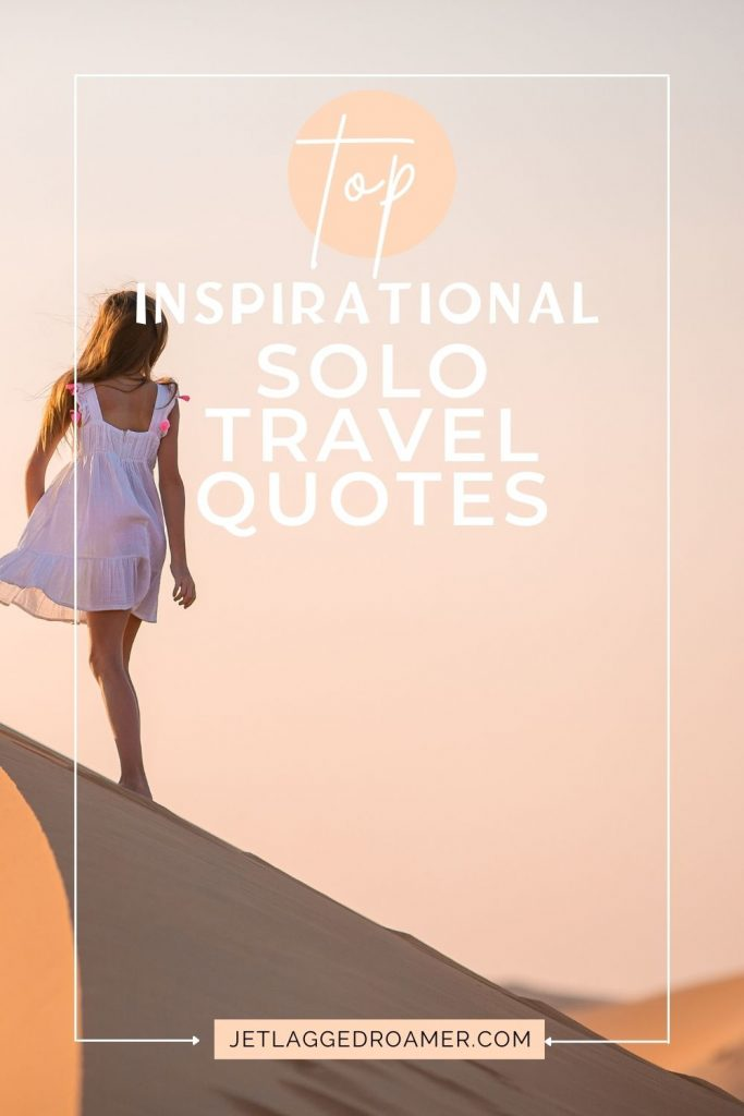 Woman standing on a sand dune in the desert. Text reads top inspirational solo travel quotes.