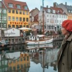 Me at the Nyhavn Canal painted houses one of the best places for solo female travel.