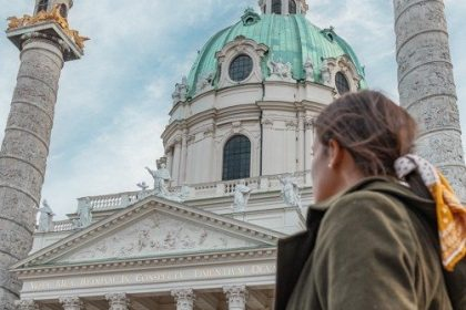 Me at KARLSKIRCHE one of the top places to see spending one day in Vienna.
