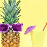 Picture of a pineapple with glass for funny travel quotes.