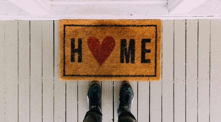 Picture of a door mat that says home.