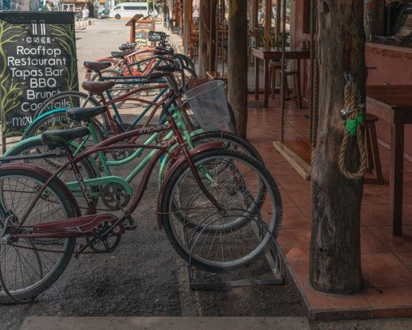 Bicycles aligned outside of a cafe in Tulum town.