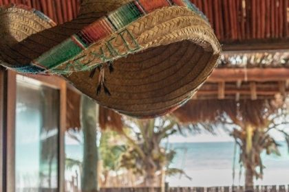 Sombrero hanging from the ceiling with the ocean in the background