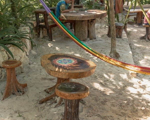 hammock and woonden tree stump table and chair