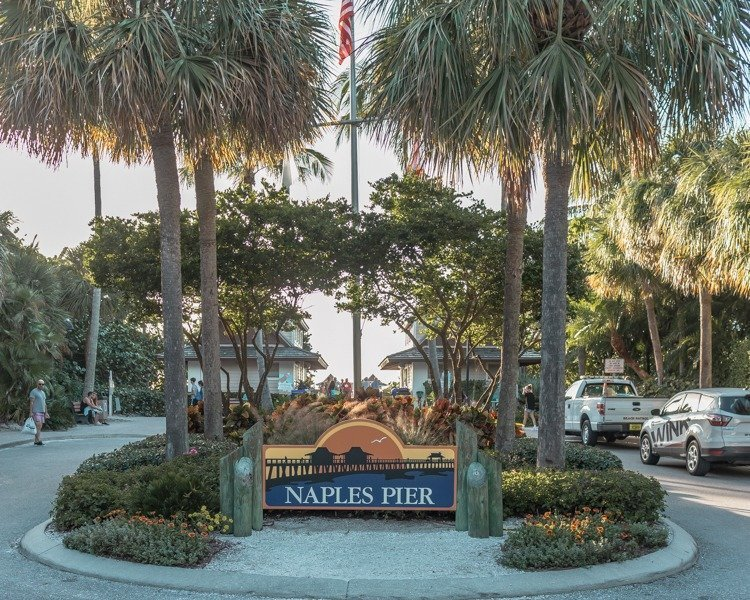 Entrance sign to Naples Pier