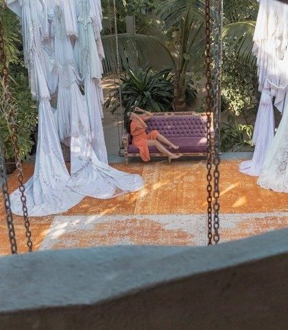 aerial view of me posing on a sofa at Casa Malca one of the top Tulum Instagram spots