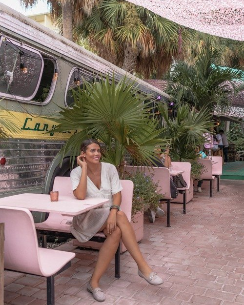 Posing at one of the pink diner tables at Case Florida Miami