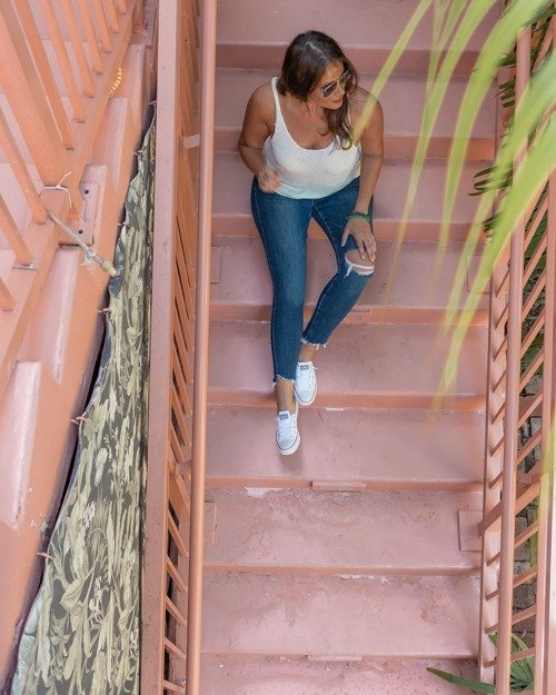 Posing on the pink stairs at Broken Shaker one of the best places to take pictures in Miami.