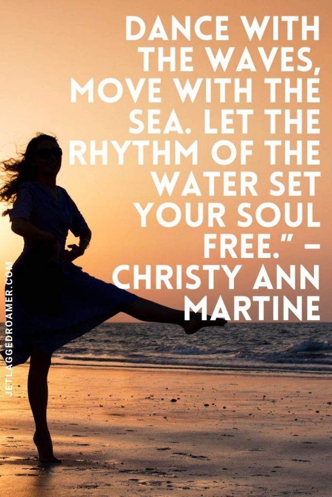 """Lady dancing along the ocean during sunset and a quote that reads """"Dance with the waves, move with the sea. Let the rhythm of the water set your soul free."""" – Christy Ann Martine"""