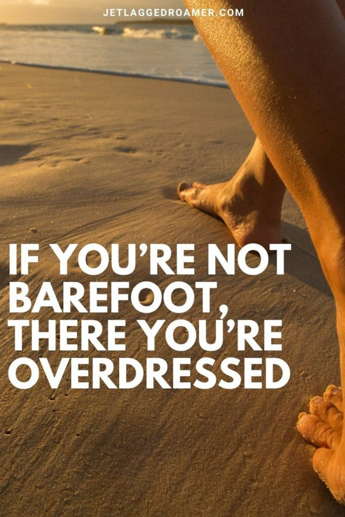 """Man walking on the beach barefoot along the shoreline during sunset and a beach caption that says """"if you're not barefoot, there you're overdressed. """""""