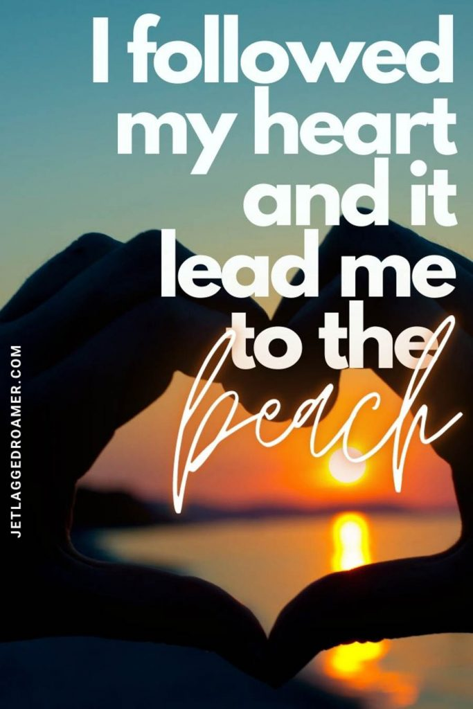 """Hands making the shape of a heart and while a sun setting inside with a quote saying """"my heart led me to the beach. """""""