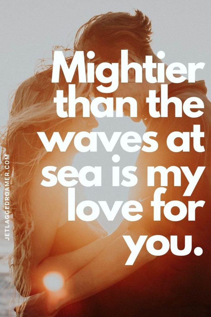 """Couple hugging while facing each other during sunset with a quote """"mightier than the waves at sea is my love for you."""""""