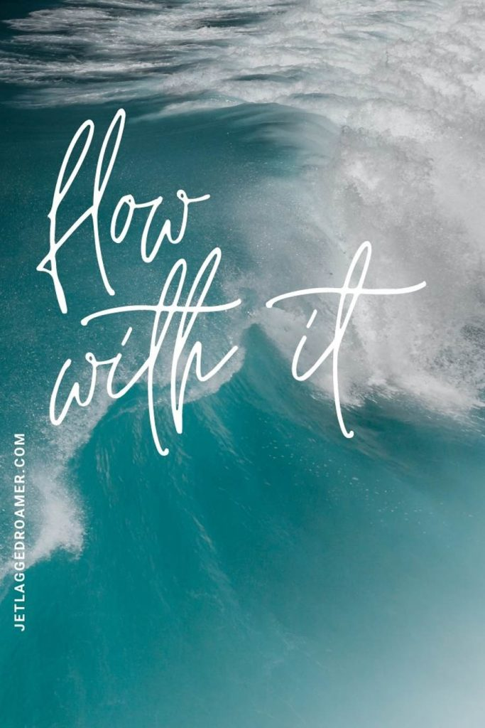 """Aerial view of a wave in the ocean and a beach quote that says """"flow with it!"""""""