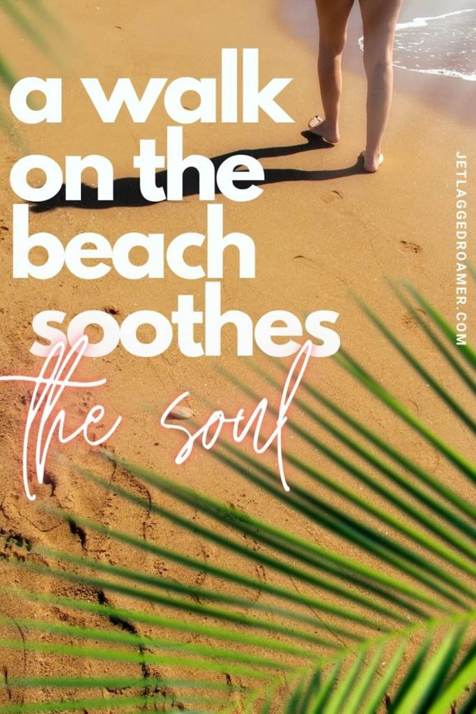 """Person walking on the beach with palm trees with a quote """"a walk on the beach soothes the soul."""""""