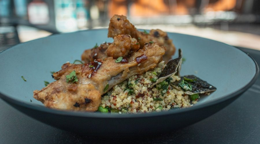 Duck wings plated nicely from Borsalino one of the top restaurants in Miami