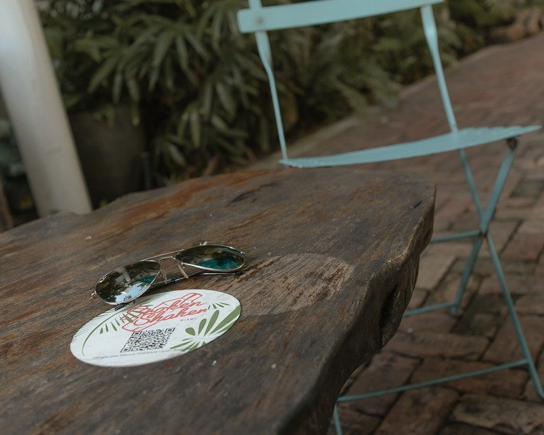 sunglasses on a table at Broken Shaker in Miami Beach