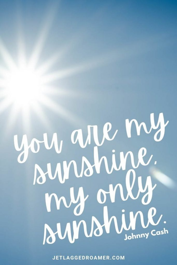 """Bright sun in a blue sky with a summer caption from Johnny Cash """"You are my sunshine, my only sunshine. """""""