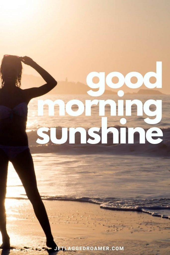 """Woman at the beach dressed in her surfer wet suit staring at the sunrise and text that says """"good morning sunshine."""""""