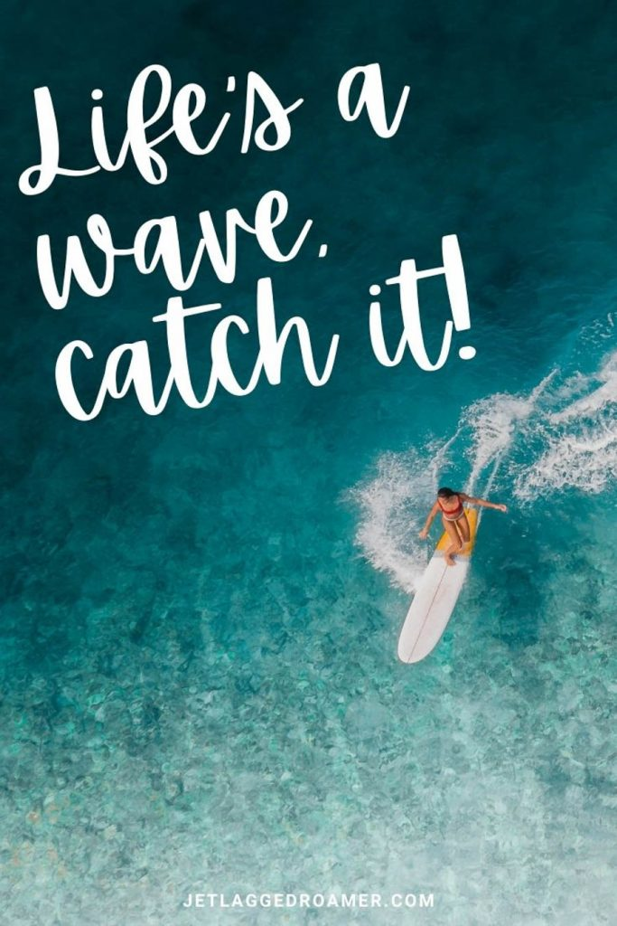 """Woman surfing on a deep blue ocean and a phrase that says """"life's a wave, catch it!"""""""