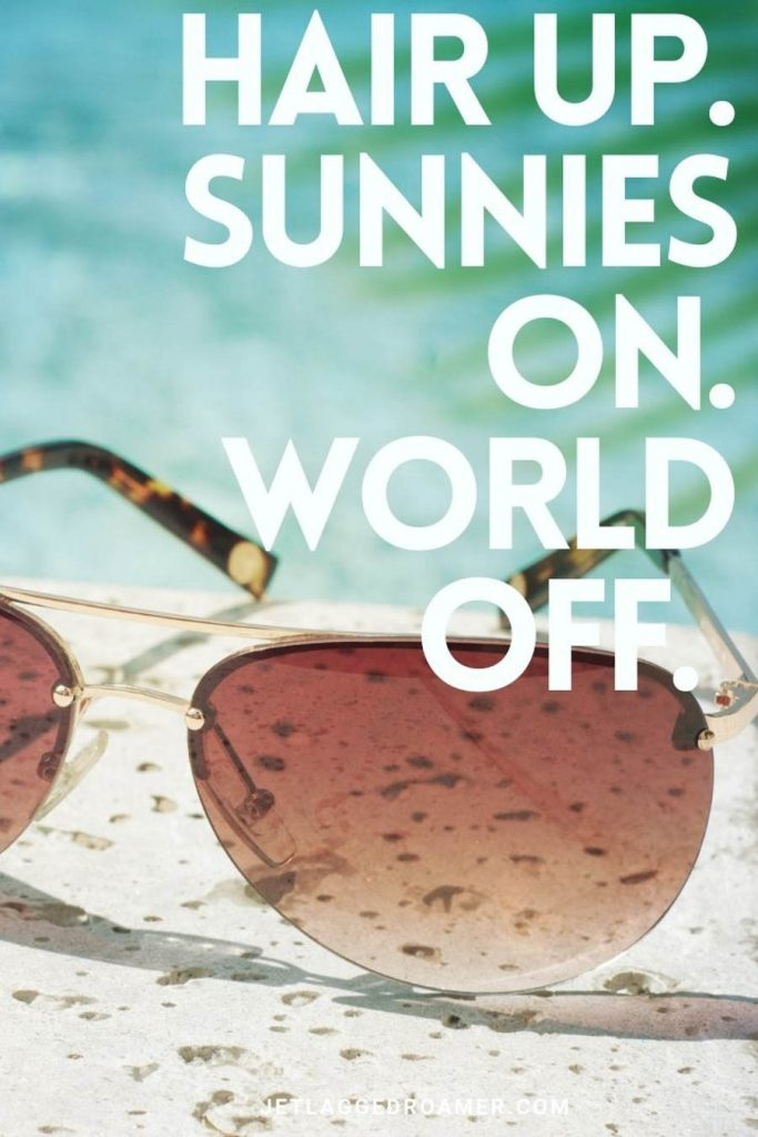 """Sunglasses perched next to a pool and a summer Instagram caption that reads """"hair up. sunnies on. world off."""""""