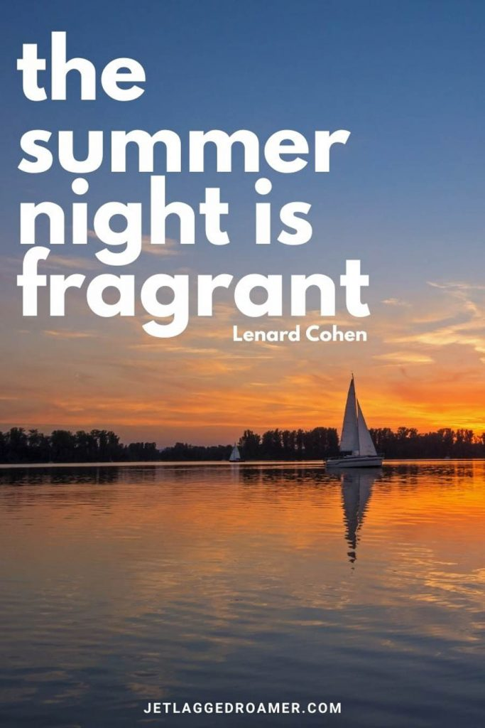 """Sun setting on a lake with one boat sailing with a summer nights quote from Lenard Cohen that says """"the summer night is fragrant."""""""