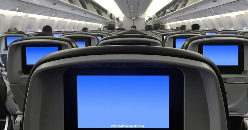 Large plane facing the front and screens on the tv shining bright blue