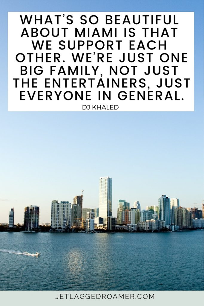 """Words from DJ Khaled """"What's so beautiful about Miami is that we support each other. We're just one big family, not just the entertainers, just everyone in general."""" in the background is  the Miami skyline far away during sunset."""