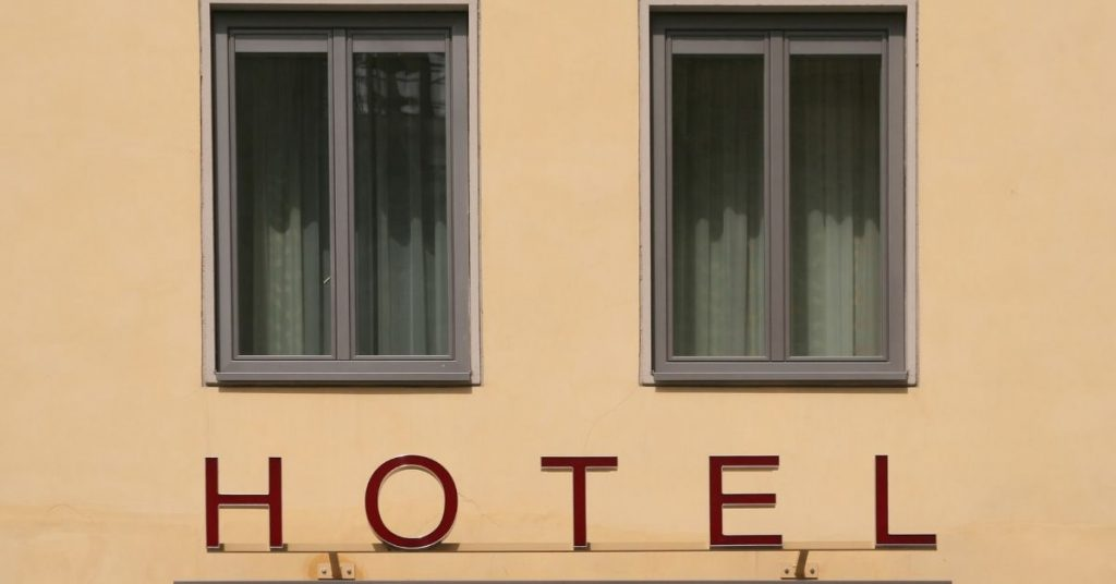 Hotel sign that says hotel in capital letters.