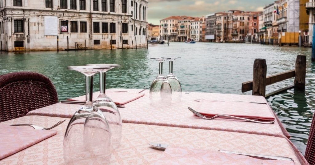 Beautiful table overlooking a canal in Italy.