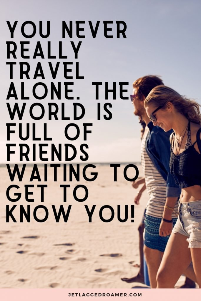 """Friends on a beach with a traveling alone quote that says """"You never really travel alone. The world is full of friends waiting to get to know you!"""""""