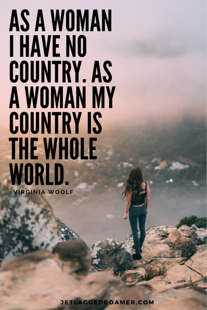 """Woman alone on a rocky mountain with a traveling alone quotes that says """"As a woman I have no country. As a woman my country is the whole world"""" by  Virginia Woolf."""