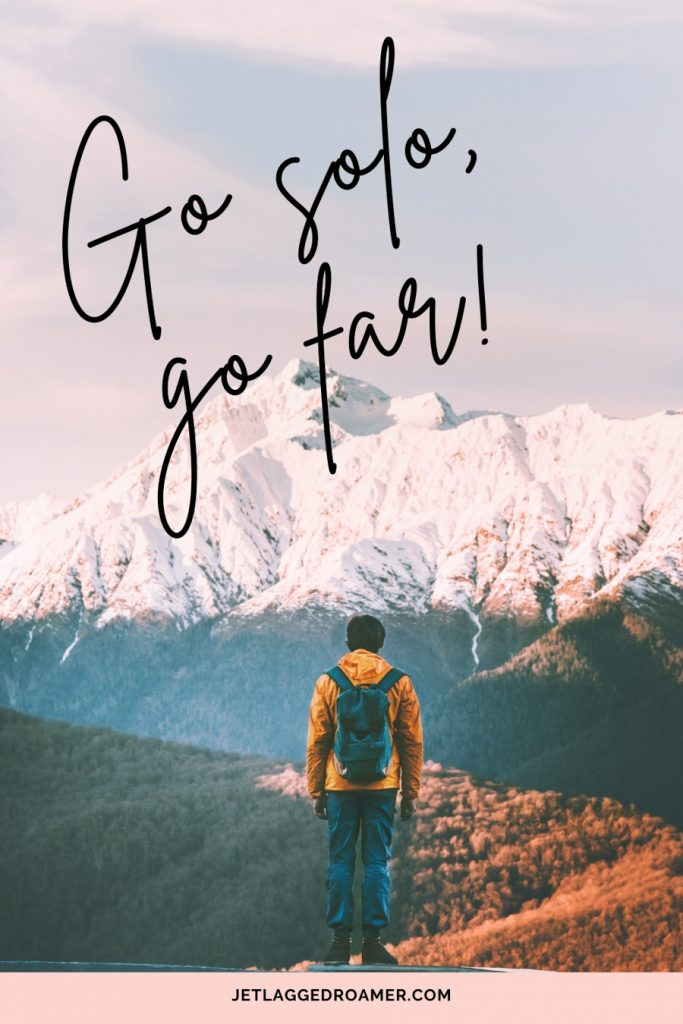 """Man overlooking the mountains with a traveling alone quote saying """"Go solo, go far."""""""