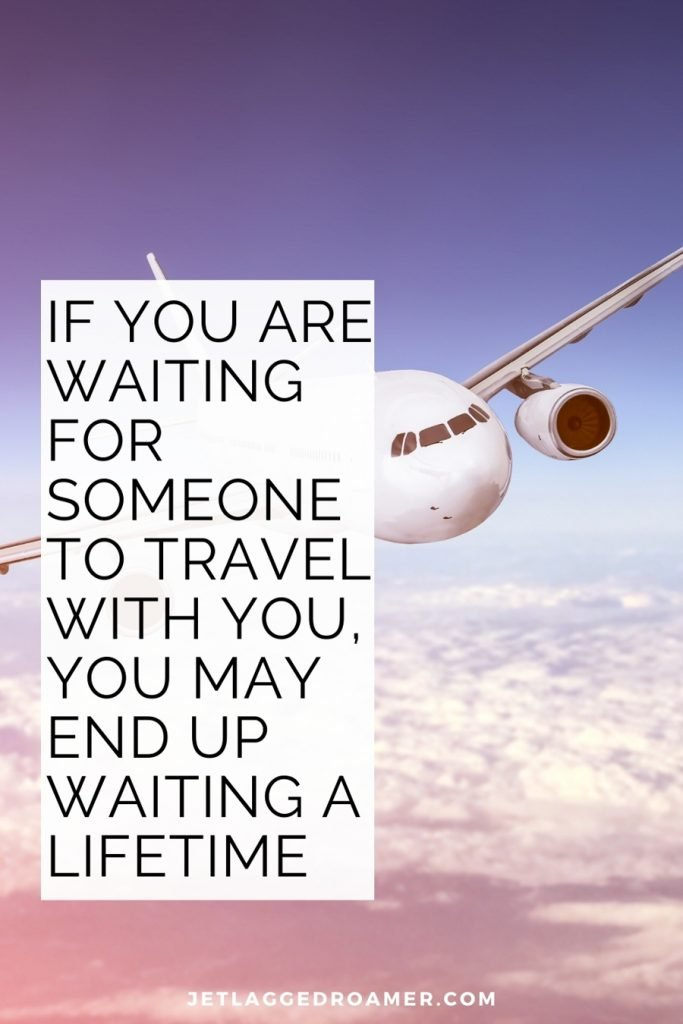"""Traveling alone quote """"If you are waiting for someone to travel with you, you may end up waiting a lifetime."""" Image of an airplane in the sky."""