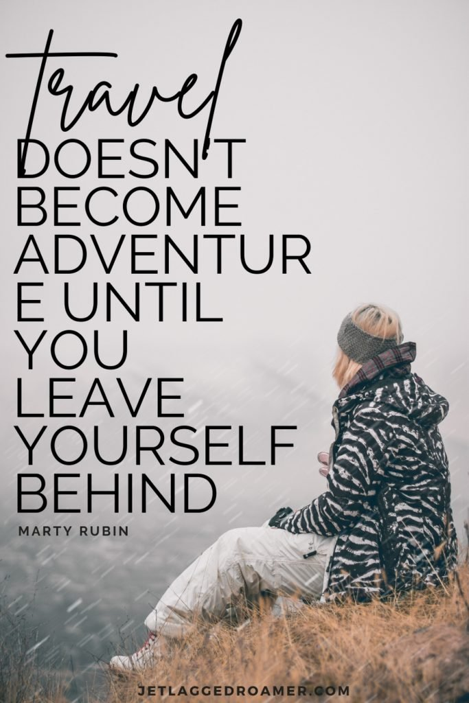 """Quote reads """"Travel doesn't become adventure until you leave yourself behind"""" by Marty Rubin. Woman siting by herself on a mountain on a foggy day."""