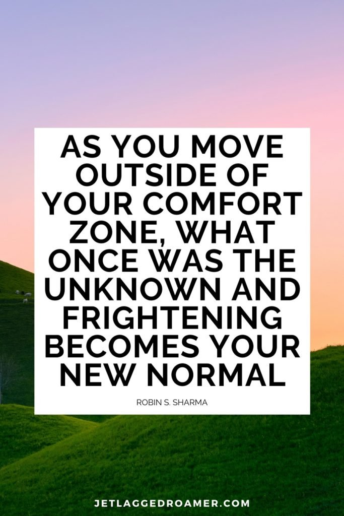 """Image of an empty plain during dusk. Travel alone quote reads """"As you move outside of your comfort zone, what once was the unknown and frightening becomes your new normal"""" by  Robin S. Sharma."""