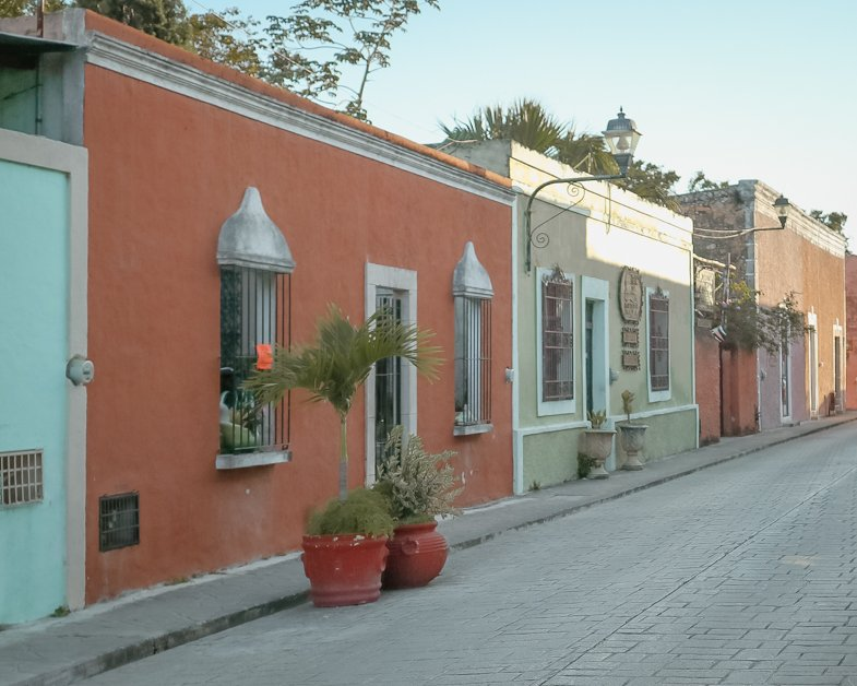 Colorful street of Calzada De Los Frailes on a sunny day.