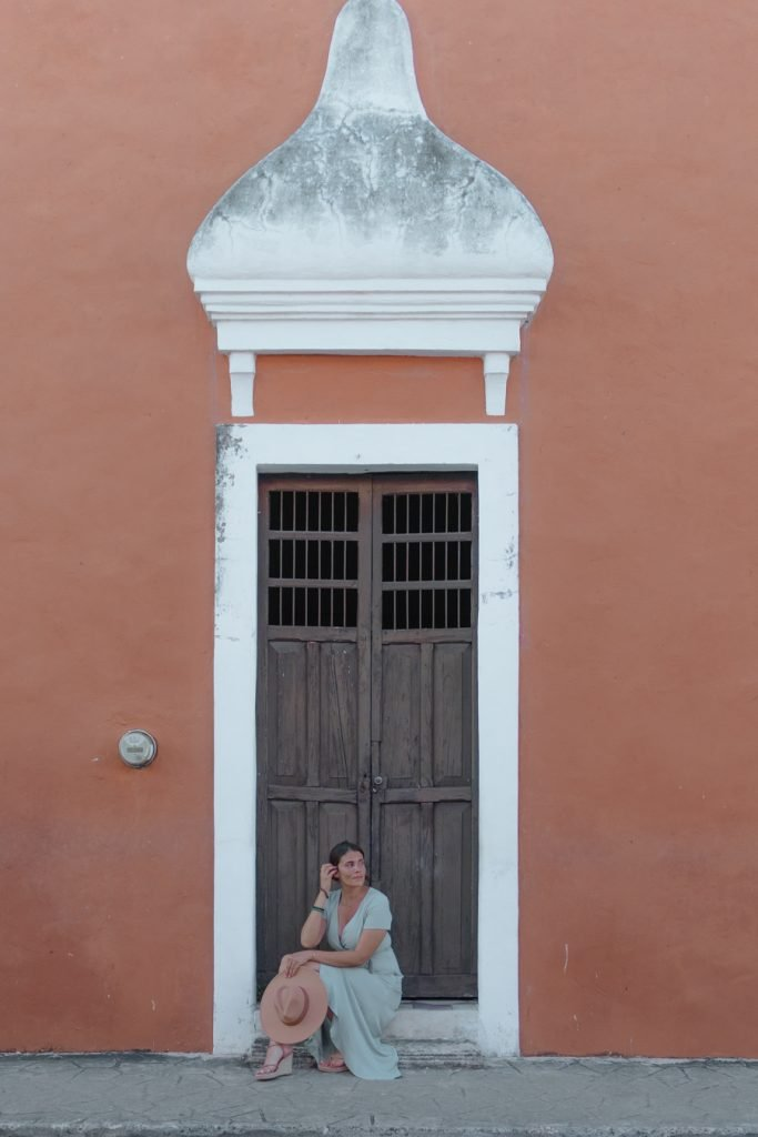 Me posing in front of a wooden door on Calzada De Los Frailes.