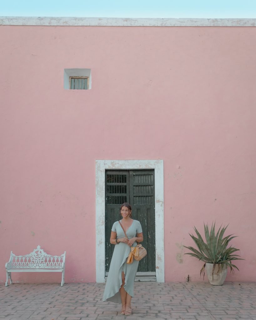 Me posing outside of a pink building off of Calzada De Los Frailes in Valladolid.