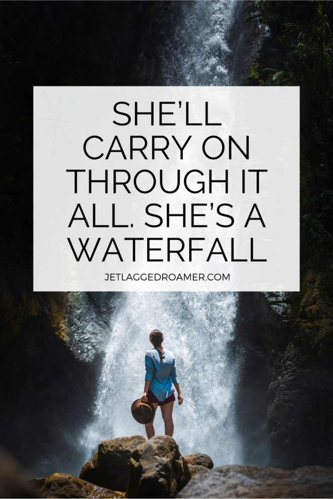 """Woman standing on a rock and text reads quote """"She'll carry on through it all. She's a waterfall.""""- Unknown"""
