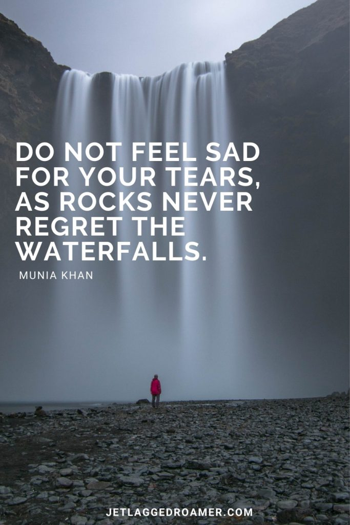 """Man standing in front of a massive waterfall and the text is an inspiring waterfall quote that reads """"Do not feel sad for your tears, as rocks never regret the waterfalls."""""""