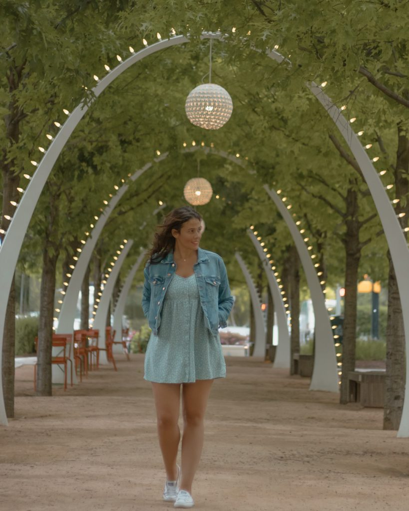Me posing under the archways at Klyde Warren Park one of the best places to take pictures in Dallas.