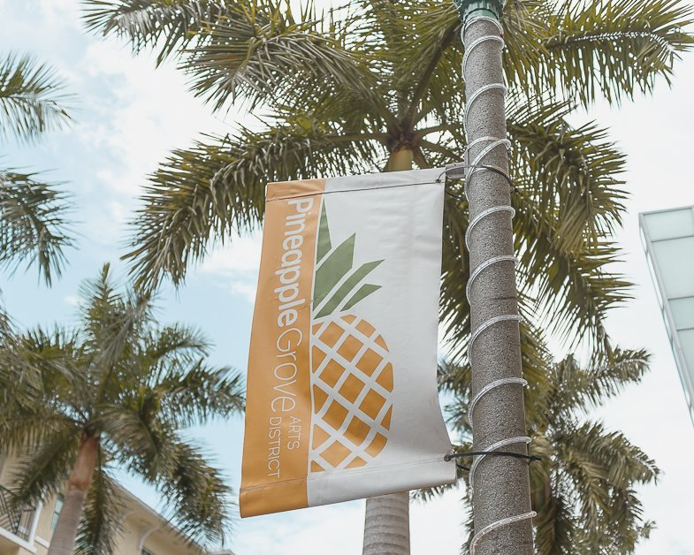 Sign with a pineapple entering into Pineapple Grove in Delray Beach.
