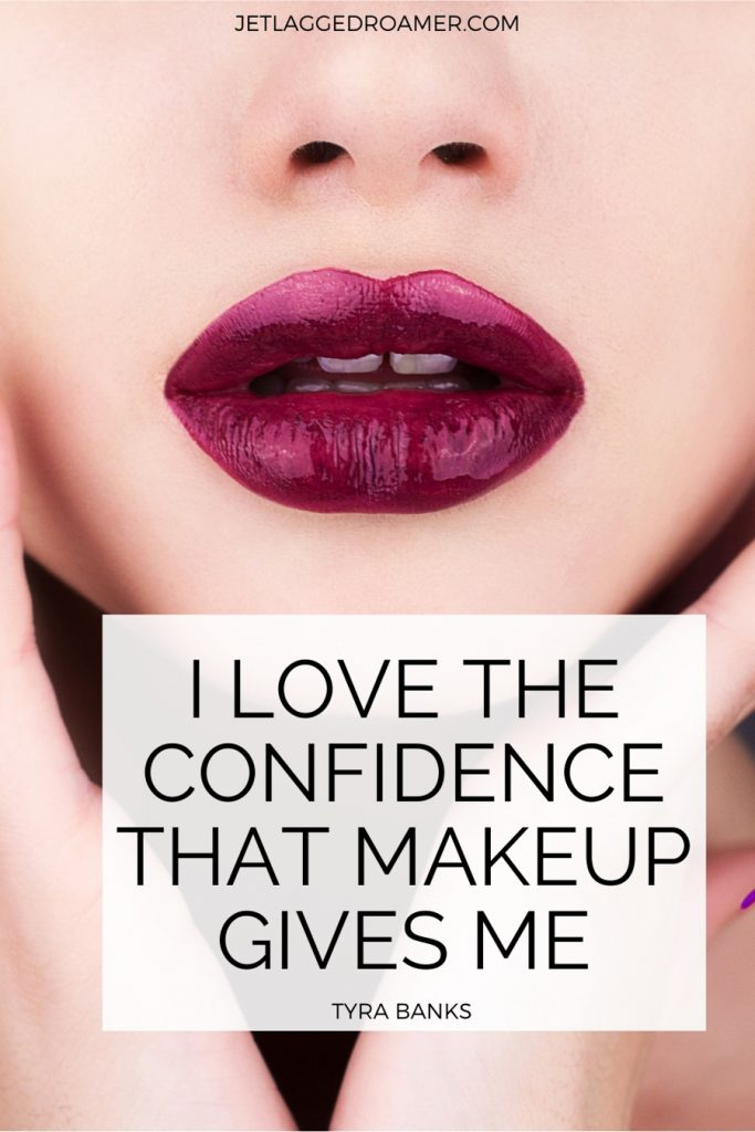 Make up quote for Instagram that reads I love the confidence that make up gives me by Tyra Banks. Image of a woman from nose to chin wearing dark lipstick.