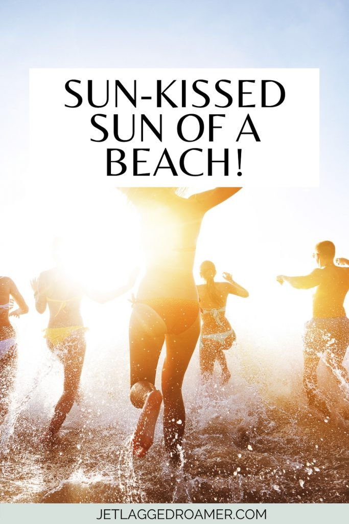 Friends running into the ocean during sunset and a sunset pun for Instagram that says Sun-kissed sun of a beach!